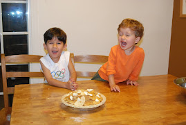 Happy boys making their first apple pie