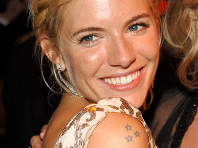 Best celebrity tattoos Sienna Miller shoulder stars tattoo