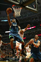 Timberwolves player dunking the ball