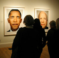 Visitors view Martin Schoeller's images of Barack Obama and John McCain at the National Portrait Gallery