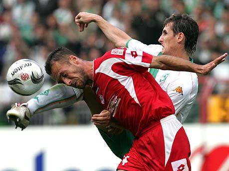 Noveski marking Miroslav Klose in his earlier days