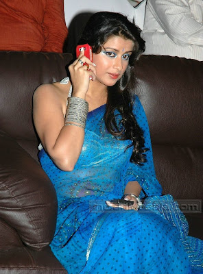 Telugu Actress Madhurima Pictures In Transparent Saree Hot posing