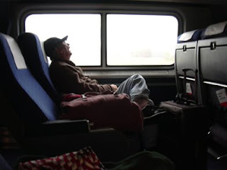 Man Sleeping on Amtrak Train