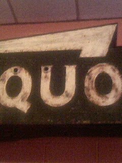 Just the Quo from Liquor sign at Beachland Ballroom