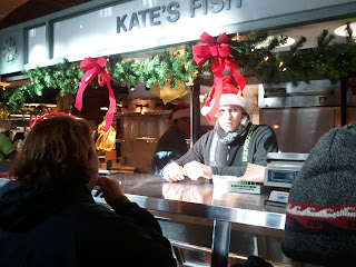 Fish Monger behind Counter at West Side Market stand
