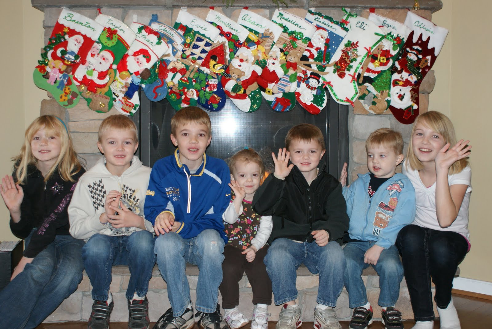 12 Kids ... And Counting?: A Dozen Christmas Stockings On The Fireplace