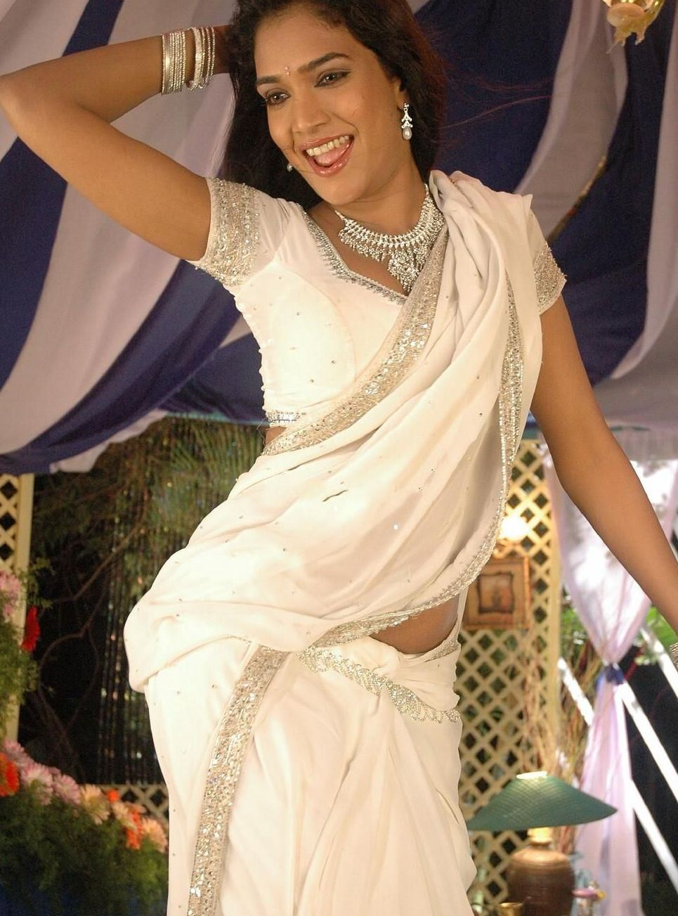 Ramya hot saree dropping scene glamour images