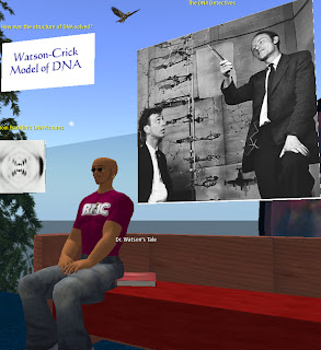 My Character in Second Life sitting on a bench in The Tower on Genome Island.  Above my character is a classic photo of the DNA Detectives Watson and Crick.