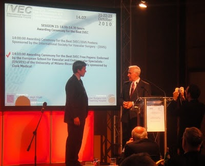 George Badham, the Whiteley Clinic venous research fellow summer 2010, being awarded his 3rd place prize at the IVEC in Milan by Professor Giorgio Biasi