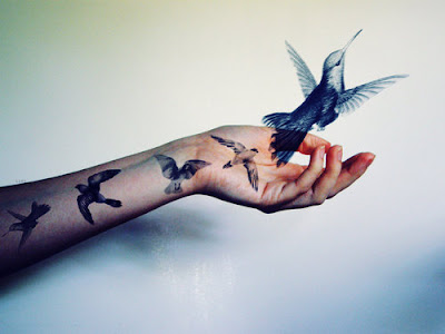 humming bird tattoo. Hummingbird Tattoo