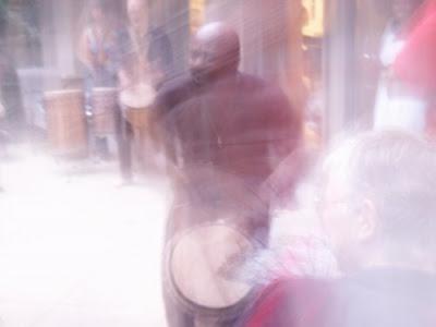 man playing djembe