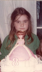 Me at 8 staring down my birthday cake!
