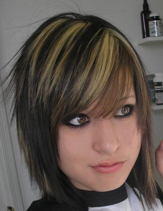 Dark brown hair with lots of blonde highlights