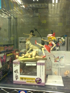 ... strange anime porn dolls including a figure of a naked woman on her ...