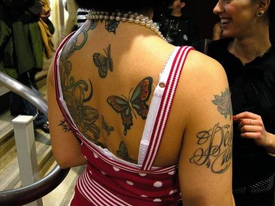 You can also combine your butterfly tattoos with other designs such as