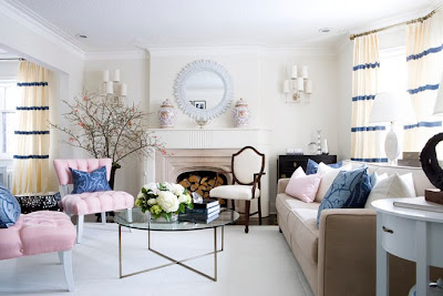 The pink chairs are balanced with blue cushions making it not look to prissy and girly.