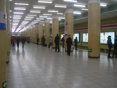 inside the station, waiting for the train