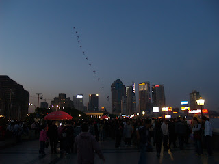 kites flying at the Bund at night