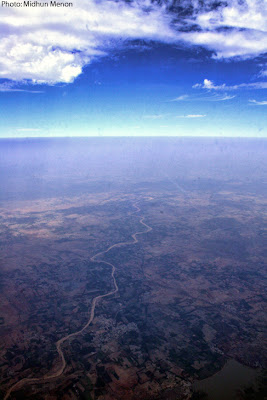 arial photography through window aircraft fine line between earth and sky
