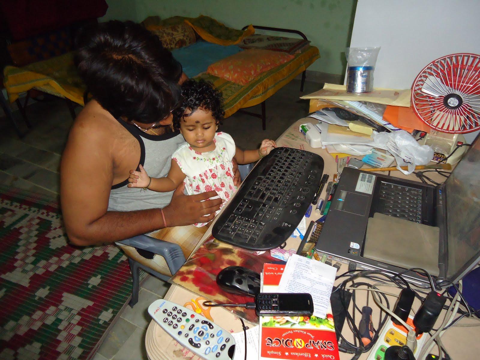 Charvitha gogineni teaching laptop to dad for Annaprasana decoration