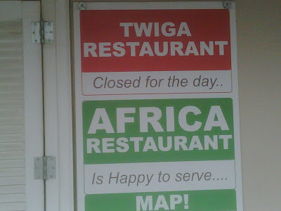 Sign at the Torongo Zoo: Twiga Restaurant. Closed for the day.. Africa Restaurant Is Happy to serve... Map!