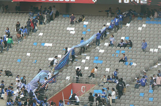 Suwon fans take their banners home