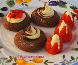 Chocolate thumbprint with a cheesecake mousse and dark choc . filling. Click on picture to view.