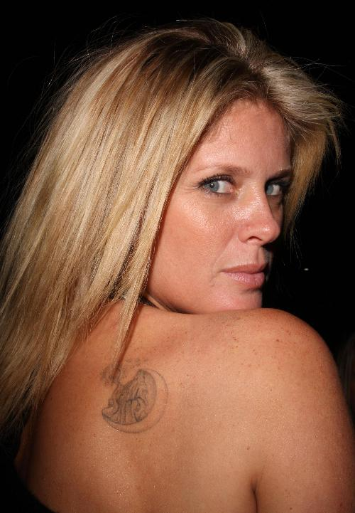 If you have more information about Rachel Hunter's tattoo designs,