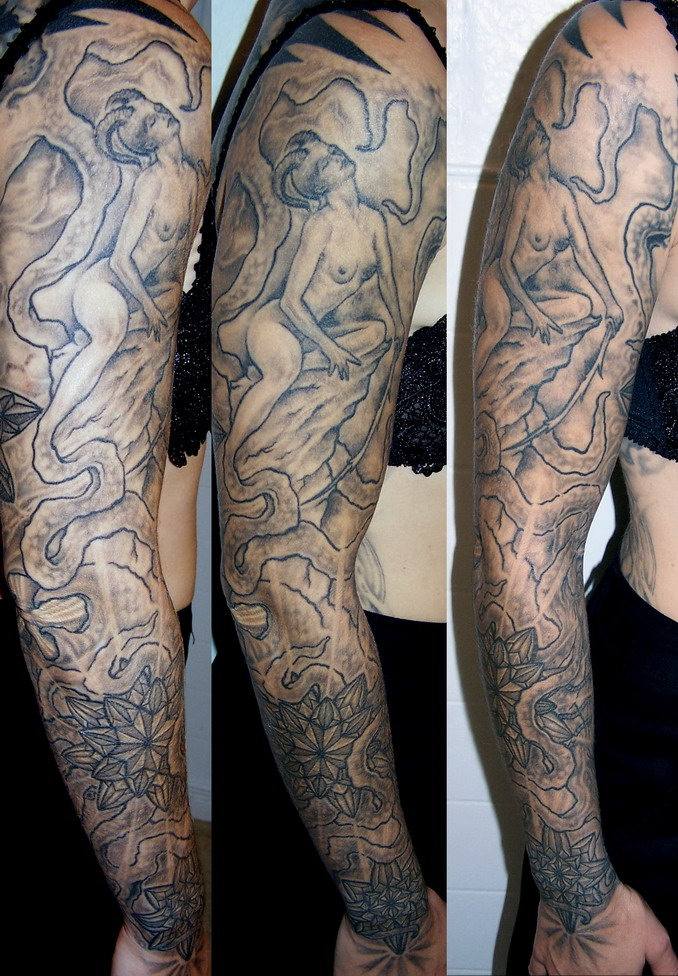 Mythical science fiction lady with horns tattoo.