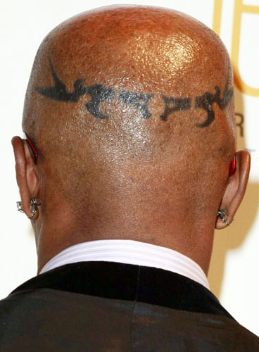 As far as we know, Jamie Foxx doesn't have any real tattoos on his body.