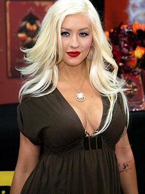 christina aguilera hairstyles. Christina Aguilera long flowing layered hairstyle.