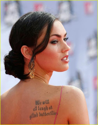 And finally, Megan Fox has a yin and yang type symbol tattooed on the inside