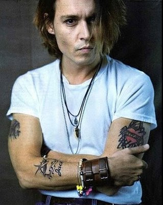 Checkout these pictures of Johnny Depp and his tattoo designs.