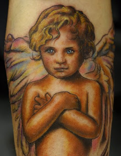 Angel Tattoos Colorful cherub tattoo.