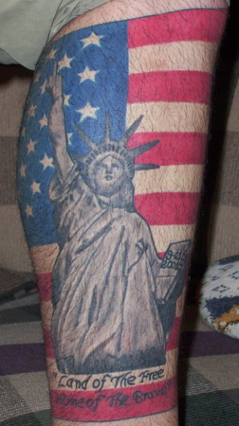 Statue of liberty with flag tattoo. 911 tattoos