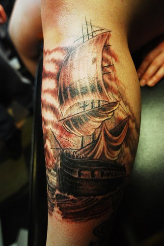 Dark haunted old ship tattoo picture.