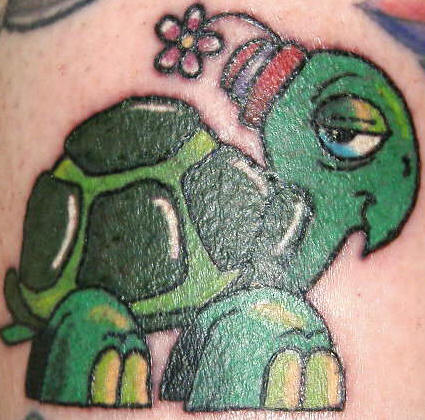 Cartoon turtle with flower tattoo.