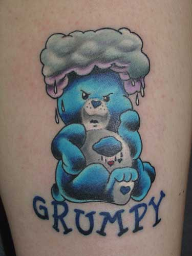 Care Bear tattoo with rainbow and clouds.