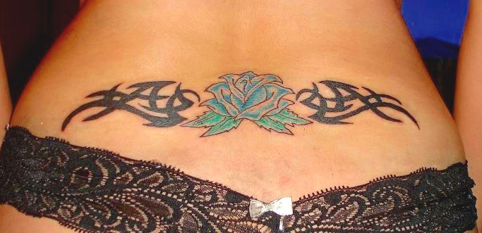 Rose flower and tribal lower back tattoo. Scripture lower back tattoo.