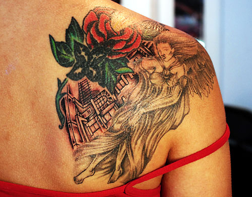 Girl with rose shoulder tattoo.