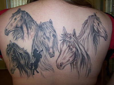 Five horse back piece tattoo.