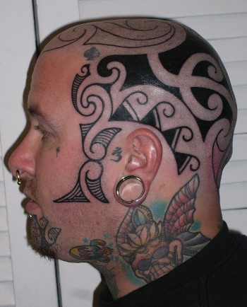 Illustration of a tribal face tattoo. Keywords: Tribal art head tattoo.
