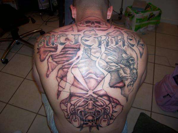 Mayan themed back piece tattoo.