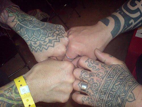 Tribal hand tattoos.
