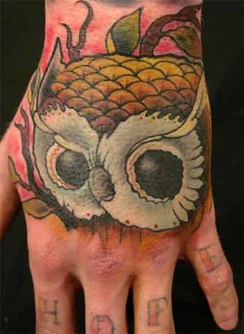 Hoot owl with hope hand tattoo.