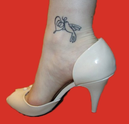 Dove ankle tattoo idea for girls.
