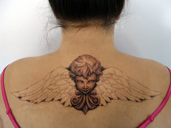 Cute Angel Tattoos. day cherub angel tattoos.