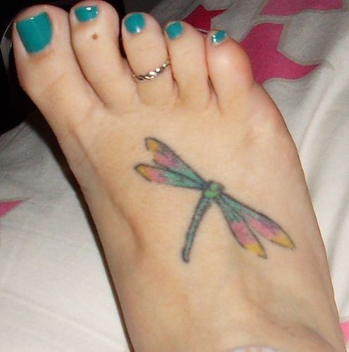 Small butterfly tattoo on foot. Small butterfly tattoo on foot.