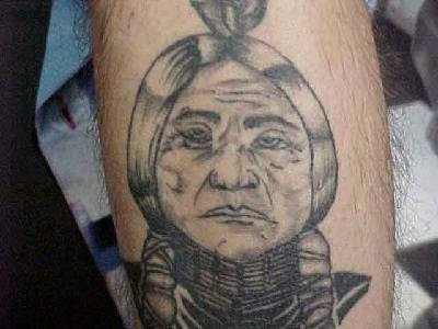 Comments: black and gray realistic native american tattoo