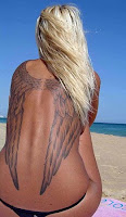 Extensive artwork on tanned woman